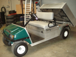 Gilchrist Golf Cars Rental Golf Cart, the Turf 2 with manual dumb box.