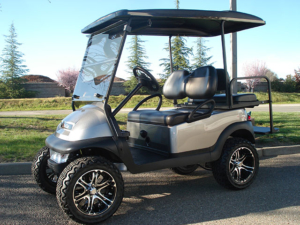 Club Car Precedent golf car, 4 passenger, with custom lifted wheels and tires.