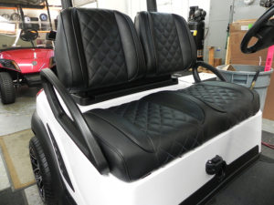 Contoured split-back black vinyl seats
