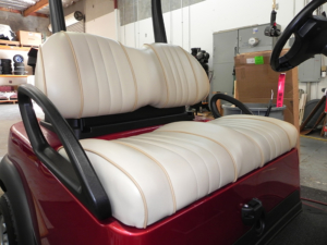 Contoured light tan vinyl seats